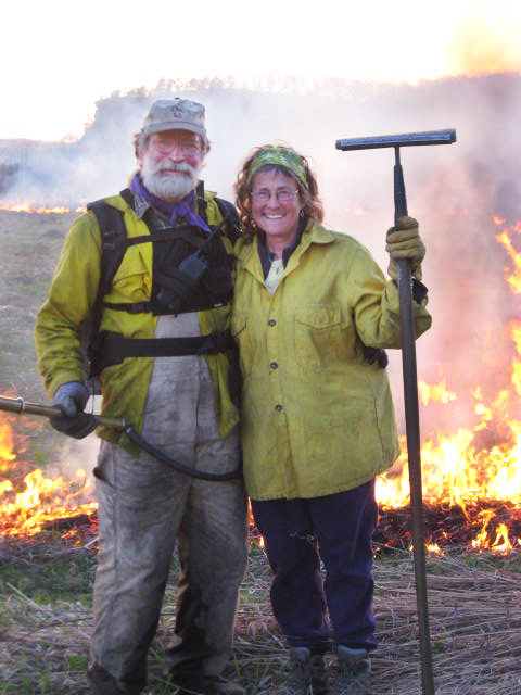 Landowners proudly pose in front of their successful prescribed burn.